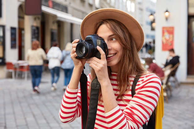 professional-female-photographer-uses-photocamera-making-pictures-takes-photo-beautiful-sights_273609-25766